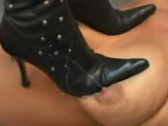 Cruel lesbian bitch trampling females milky tits with boots on high heels